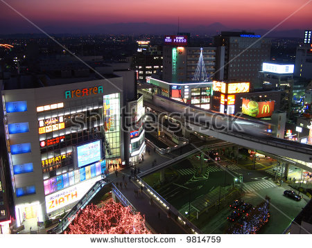 Tachikawa Tokyo Twilight Monorail Train Rushing Stock Photo.