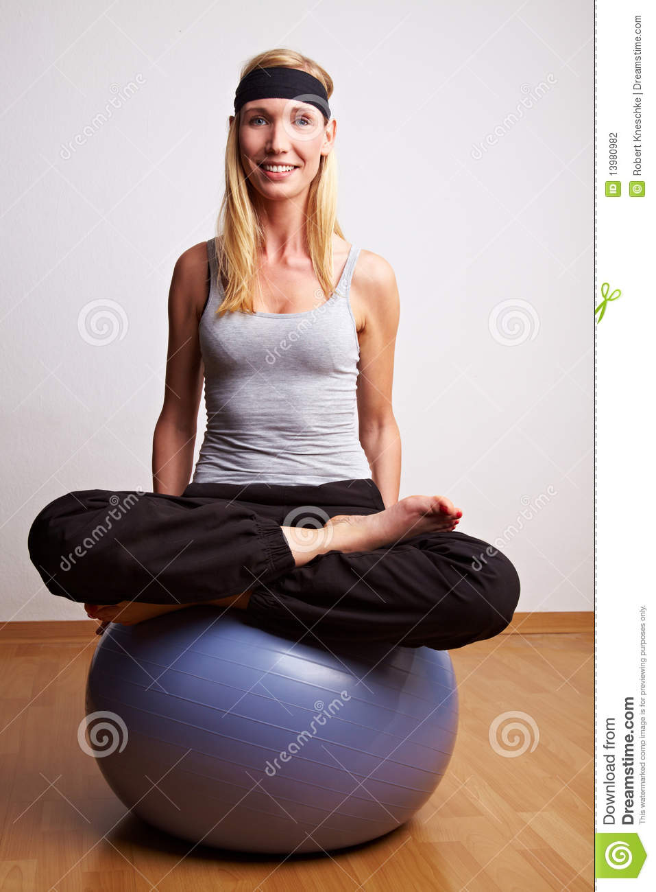 Woman In Tailor Seat On Gym Ball Stock Photography.