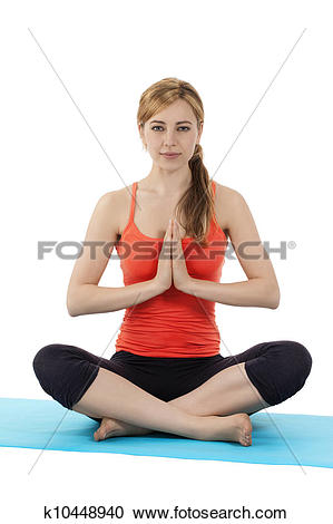 Stock Photography of young fitness woman exercising yoga in tailor.