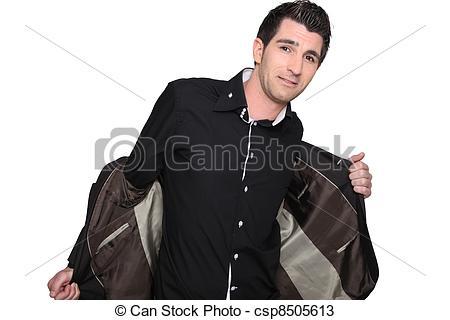 Stock Photos of Man taking off his jacket csp8505613.