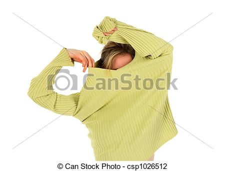 Stock Photo of Girl taking off a sweater.