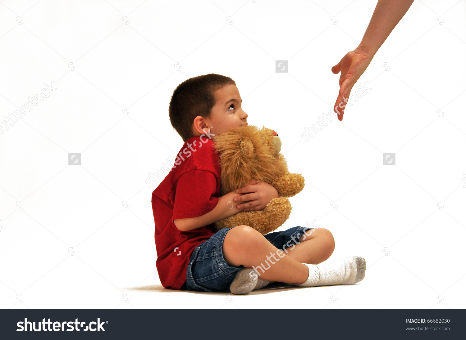 Young Boy Clutching His Stuffed Lion Stock Photo 66682030.