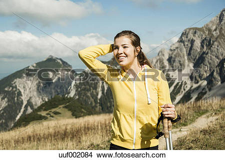 Stock Photo of Austria, Tyrol, Tannheim Valley, smiling young.