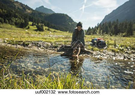 Stock Photo of Austria, Tyrol, Tannheimer Tal, young female hiker.