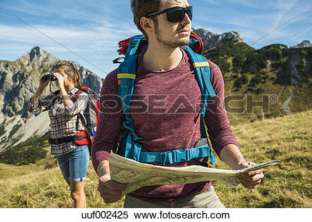 Stock Image of Austria, Tyrol, Tannheimer Tal, young couple hiking.