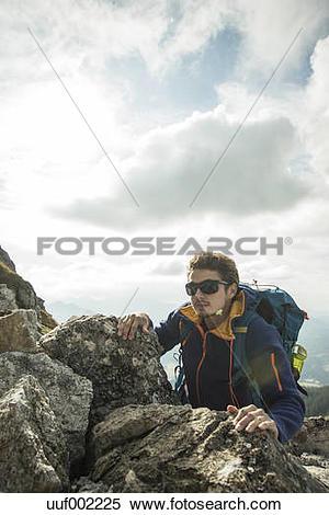 Stock Image of Austria, Tyrol, Tannheimer Tal, young man climbing.