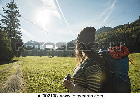 Pictures of Austria, Tyrol, Tannheimer Tal, young female hiker.