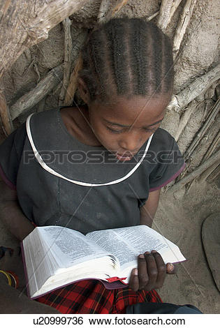 Stock Images of bible, girl, reading, tanzania, person, people.