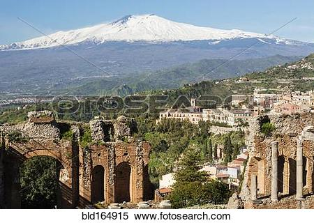 Stock Image of Mount Etna and Greek Theater ruins over Taormina.