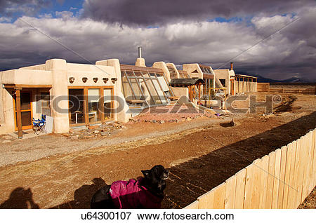 Picture of earthship adobe home house dog taos new mexico.