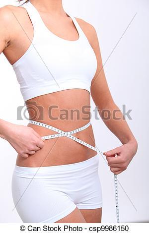 Closeup of tape measure around woman waist.
