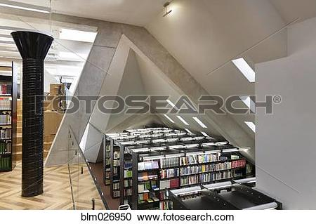 Stock Photography of Balcony overlooking bookshelves in library at.