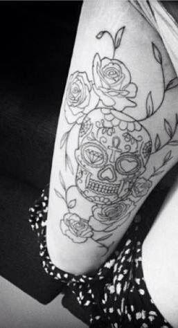 Sugar Skull thigh tattoo with rose vines..