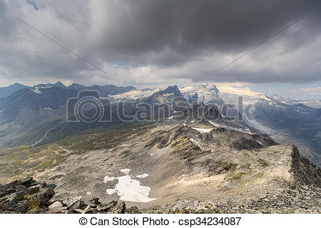 Pictures of Dark storm clouds over mountain Grossvenediger and.