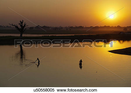 Stock Image of Myanmar, Mandalay, Lake Taungthaman. Fishermen on.