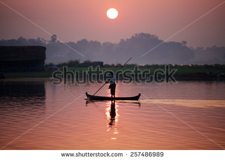 Taungthaman Lake With Boat In Amarapura, Myanmar(Burma). Stock.