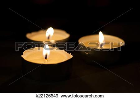 Stock Photograph of Three burning tea lights k22126649.