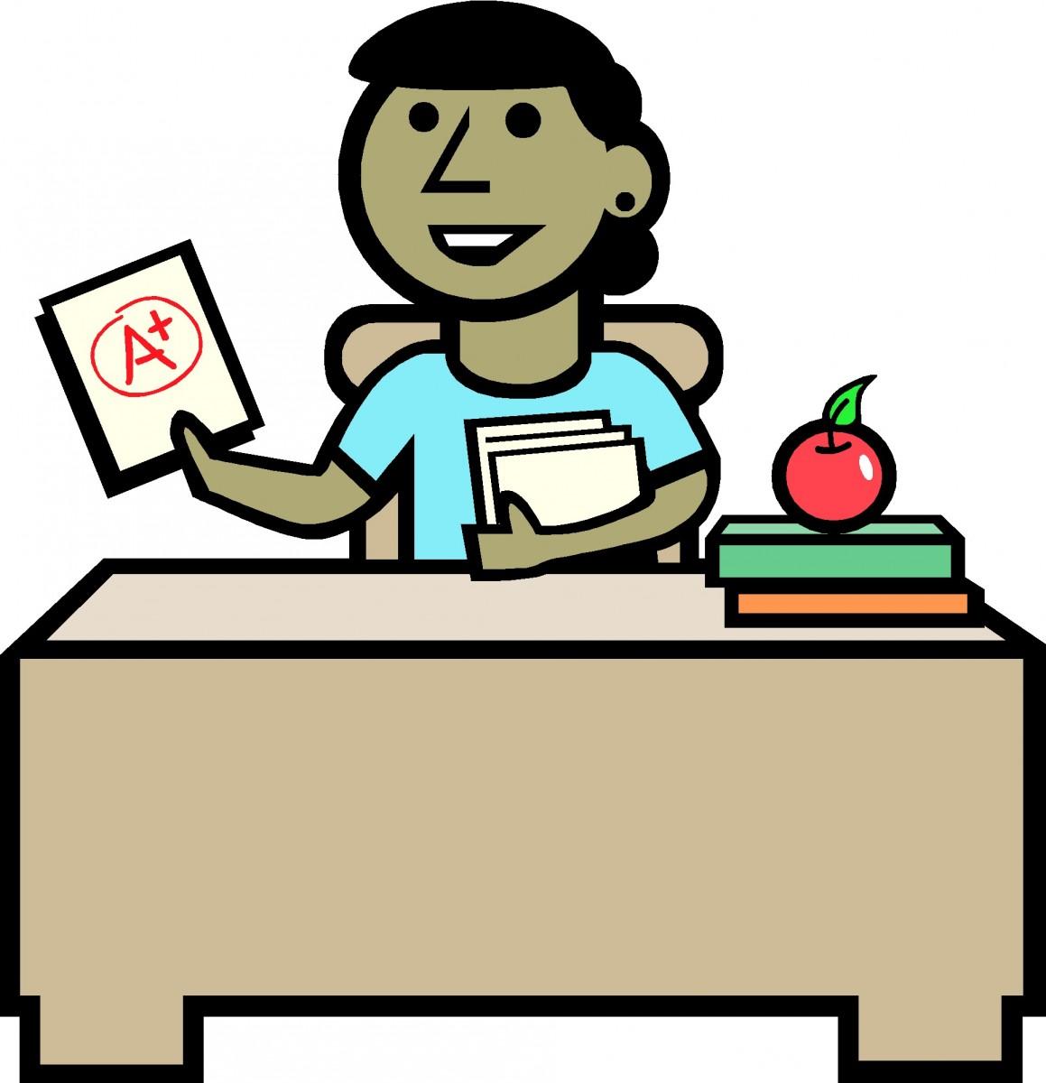 teacher sitting at desk.