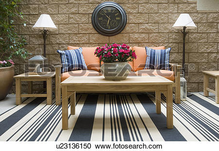 Stock Photography of Outdoor patio with teak furniture u23136150.