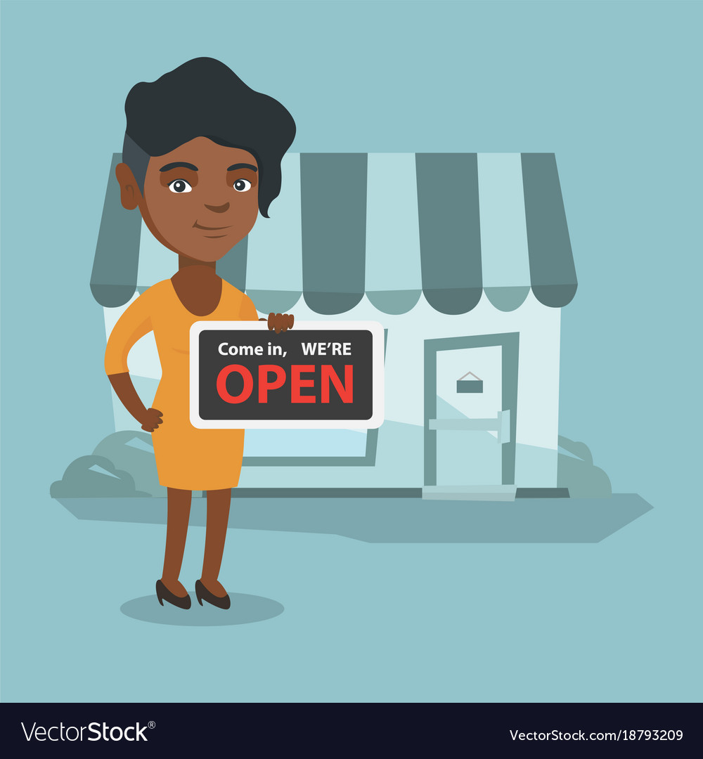 Young african shop owner holding open signboard.