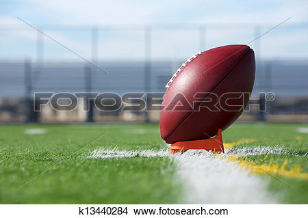 Stock Photo of Pro Football teed up for kickoff k13440284.
