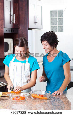 Pictures of mother teaching teen daughter cooking k9097328.