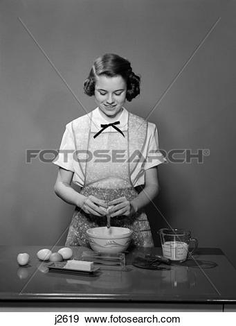 Stock Photograph of 1950S Young Teen Girl Wearing Apron Braking.