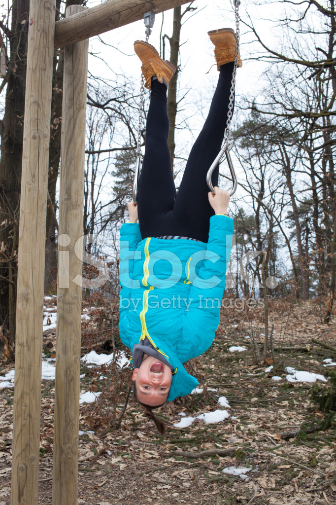 Pretty Girl IS Upside Down Dangling Stock Photos.