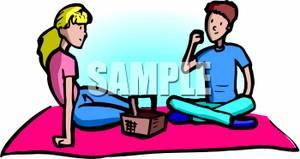 A Teenage Boy And Girl Having A Picnic.