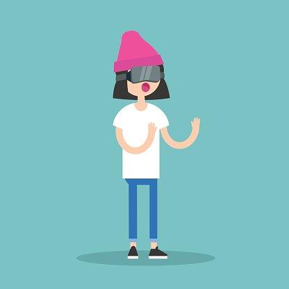 Young Teenage Girl Wearing Virtual Reality Glasses premium.