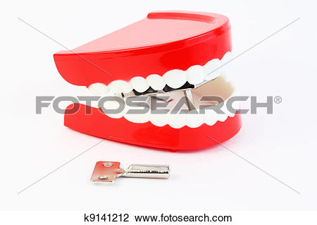 Stock Photo of small toy jaw with white teeth swallowed mechanism.
