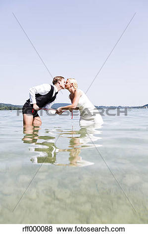 Pictures of Germany, Bavaria, Tegernsee, Wedding couple standing.