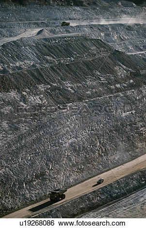 Stock Images of Earth moving trucks open cut gold mine Telfer.