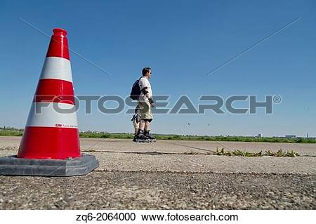Stock Photography of Traffic Cone on the Runway of the former.
