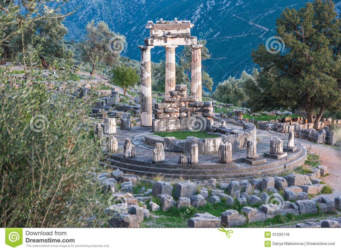 Ruins Of An Ancient Greek Temple Of Apollo At Delphi, Greece Stock.