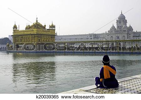 Stock Image of Sikh Man sitting on Marble steps of Tank.