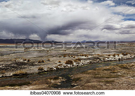 """Pictures of """"Termas de Polques hot springs with water spouts."""