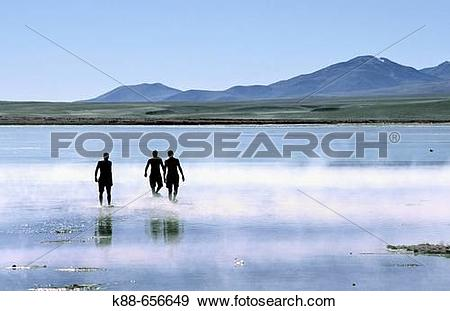 Stock Photograph of Tourists bathing in hot springs. Termas de.