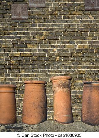 Stock Images of Terracotta chimney pots.