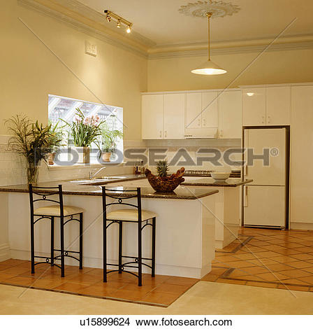 Stock Photograph of Wooden apex ceiling in modern pale wood.