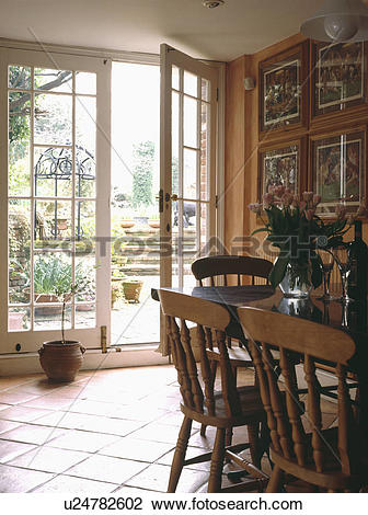 Stock Photo of Pine furniture in dining room extension with.