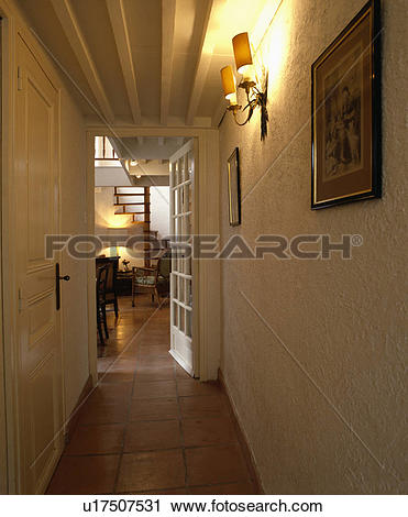 Stock Photography of Terracotta tiled floor and roughly plastered.