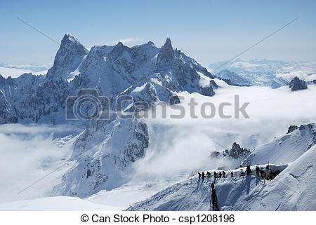 Stock Image of Mountain range between white clouds and path with.
