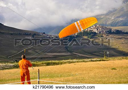 Stock Images of Man doing paragliding in the Apennines landscapes.