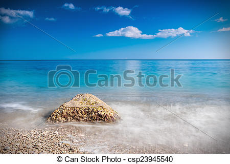 Stock Photo of stone washed by the waves on the beach.
