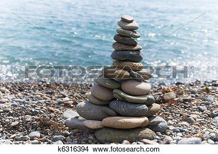 Stock Photo of Stone pyramid on the beach k6316394.