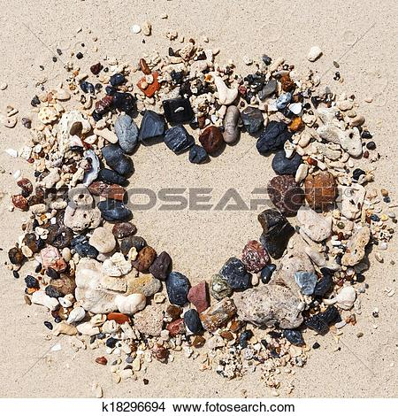Stock Photo of Stone arrangement as heart frame on the beach.