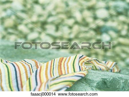 Stock Photo of beach, stone, fabric, cloth, fabrics, stripe.