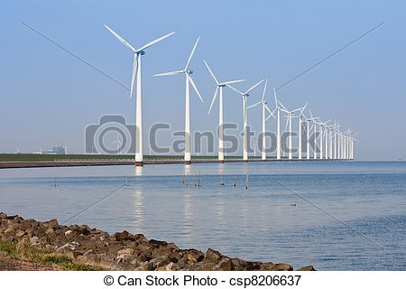 Picture of Windmills along the coastline, mirroring in the calm.