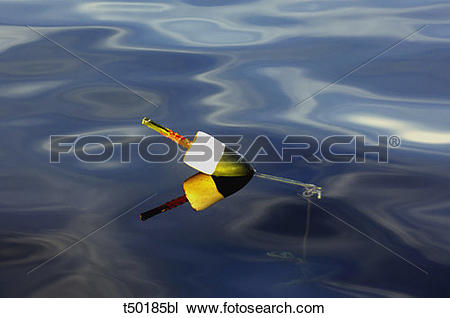 Stock Photo of Colorful lobster buoy floating in the calm sea.